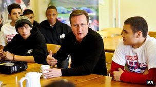 David Cameron speaking to teenagers taking part in an activity camp in mid-Wales