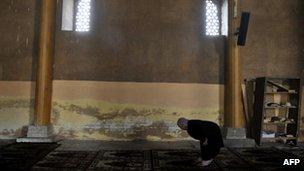 A Kashmiri Muslin in Srinagar's Jamia Masjid mosque