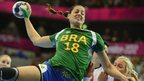 Brazil&#039;s leftback Eduarda Amorim jumps to shoot as she vies with a Norwegian player