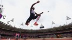 Phillips Idowu of Great Britain competes in the men's triple jump