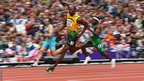 Jamaica's Usain Bolt leads Noah Akwu of Nigeria in the men's 200m heats
