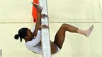 Gabrielle Douglas of the United States falls off the beam