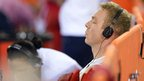 Great Britain's Chris Hoy listens to music before competing in the men's keirin