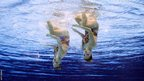 China's Liu Ou and Huang Xuechen compete in the duets free routine final