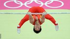 China's gymnast Kai Zou performs during the men's horizontal bar final