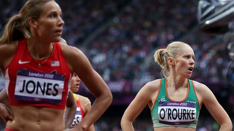 Derval O'Rourke (right) looks at the results with American Lolo Jones after Tuesday's semi-final