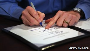 Man&#039;s hands sign bill