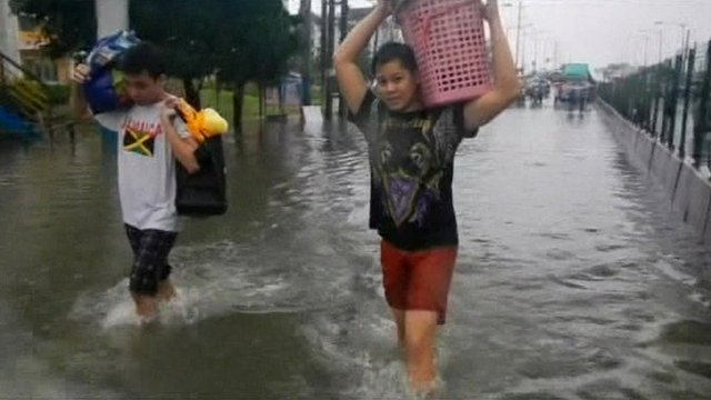 Two residents in a flooded area of Manila