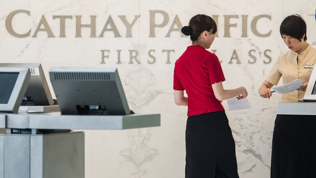 Cathay Pacific employees at the airport in Hong Kong 