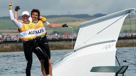 Australian sailors Nathan Outteridge and Iain Jensen celebrate winning gold in the men's 49er class at London 2012