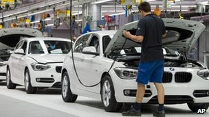 Worker at BMW factory in Germany, one of the country's largest exporters