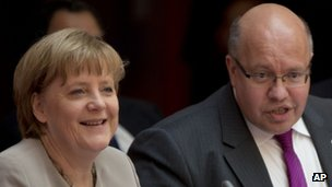 Chancellor Angela Merkel and environment minister Peter Altmaier