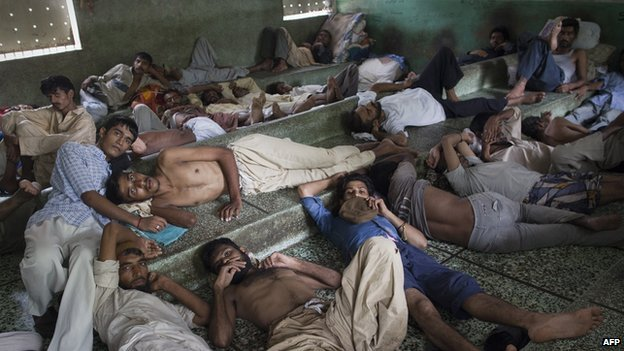 Pakistani heroin addicts rest at the Edhi rehabilitation centre in Karachi