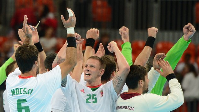 Hungary&#039;s handball team celebrate winning their quarter-final against Iceland.