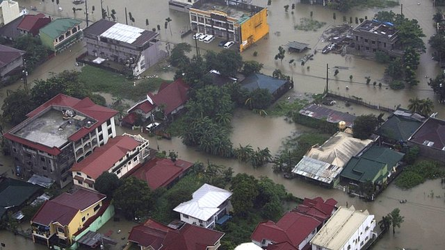 Philippine Air Force aerial photograph of buildings submerged by floodwaters