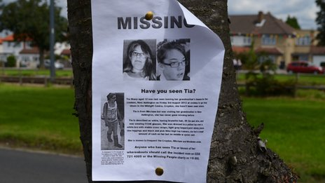 Missing person poster stuck to a tree