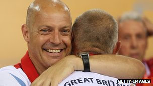 Dave Brailsford hugs coach Shane Sutton at the London 2012 Olympics