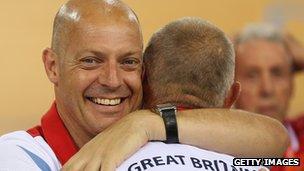 Dave Brailsford hugs coach Shane Sutton at the London 2012 Olympics