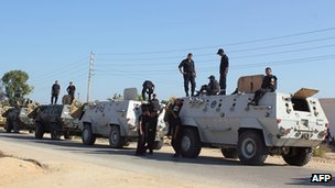 Egyptian security forces stand by their armoured personnel carriers ahead of a military operation in the northern Sinai peninsula on 8 August