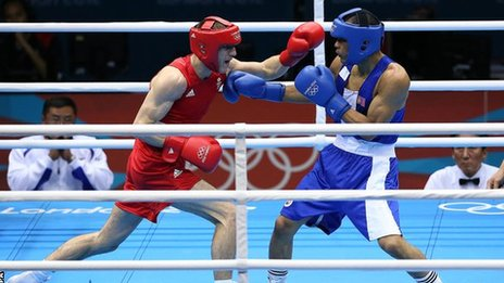 Thomas Stalker (red) in action against Mongolia's Munkh-Erdene Uranchimeg