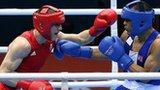 Thomas Stalker (red) in action against Mongolia's Munkh-Erdene Uranchimeg