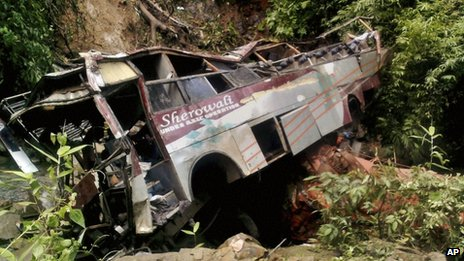 Wreckage of a passenger bus is seen after it fell into a gorge in Tongseng village in Meghalaya state, India, Wednesday, Aug. 8, 2012.