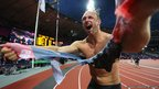 Robert Harting of Germany celebrates winning gold in the men's discus