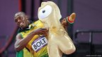 Usain Bolt of Jamaica celebrates winning gold