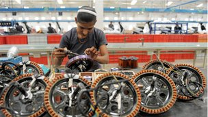 An Indian woman at work in a coil factory