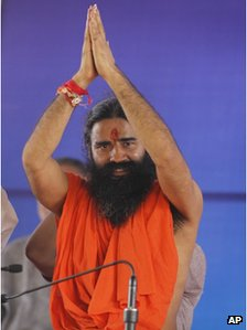 Indian yoga guru Baba Ramdev greets his supporters during a mass anti corruption protest, in New Delhi, India , Thursday, Aug. 9, 2012