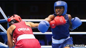 Nicola Adams punching Mary Kom