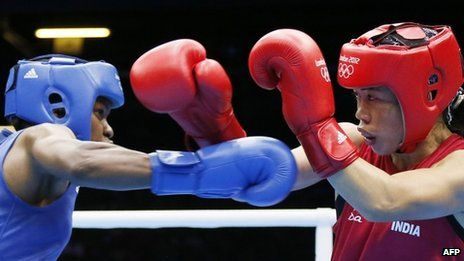 Indian boxer MC Mary Kom (R) fights Great Britain's Nicola Adams at the London 2012 Olympics