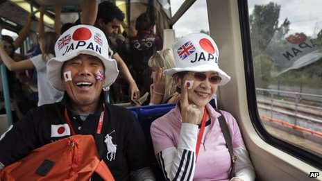 Two visitors from Japan ride the train to go and watch the judo competition at the 2012 Summer Olympics
