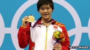 "Gold medallist Shiwen Ye of China poses on the podium during the medal ceremony in the Women""s 200m Individual Medley final"