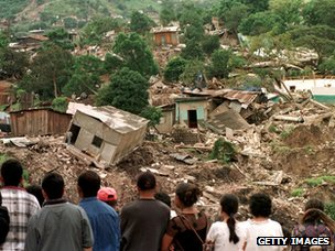 Tegucigalapa residents look at some of the homes destroyed by a mudslide on Cerro El Berrinche