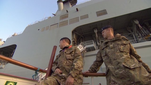 Soldiers return to HMS Ocean after a 12-hour shift at the Olympics