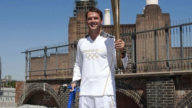 Michael Owen holds the Olympic torch