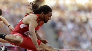 US hurdler Jason Richardson and his famous locks in full flow over the hurdles