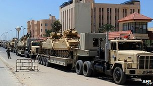 Trucks carrying tanks in al-Arish