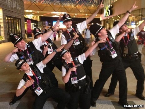 Police officers struck a Usain Bolt pose