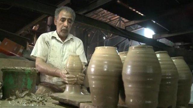 A man throwing a pot