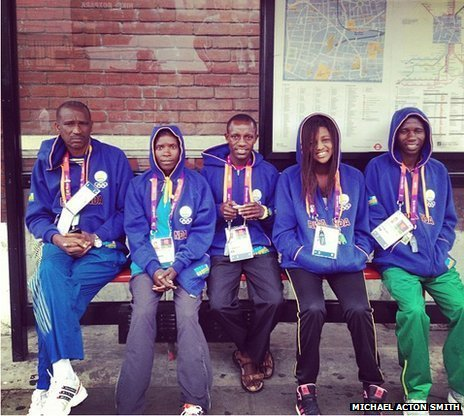 Team Rwanda members waiting for a bus