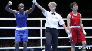 Nicola Adams, left, reacts as she is declared the winner over China's Ren Cancan during their Women's Fly gold medal boxing match