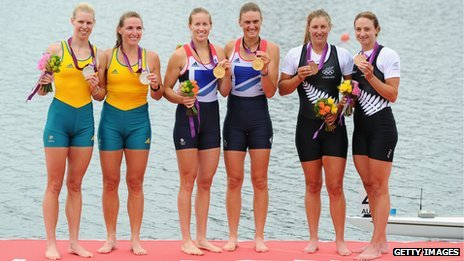 Rowers displaying their medals