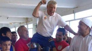 Alwyn Belcher celebrates Nicola Adams's win