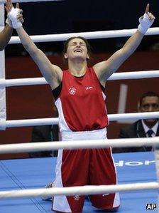 Katie Taylor celebrates her win over Russia's Sofya Ochigava