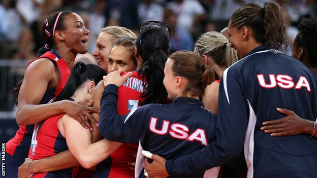 USA celebrate reaching the Olympic women's volleyball final