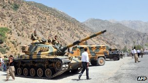 Heavy armoured vehicles of Turkish military are stationed in front of Gecimli military outpost on 5 August 2012 at Cukurca in Hakkari