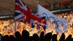 Olympic flame alongside the flags of Great Britain and the Olympics