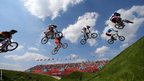 Riders clear the jump during the Men's BMX cycling quarter-finals